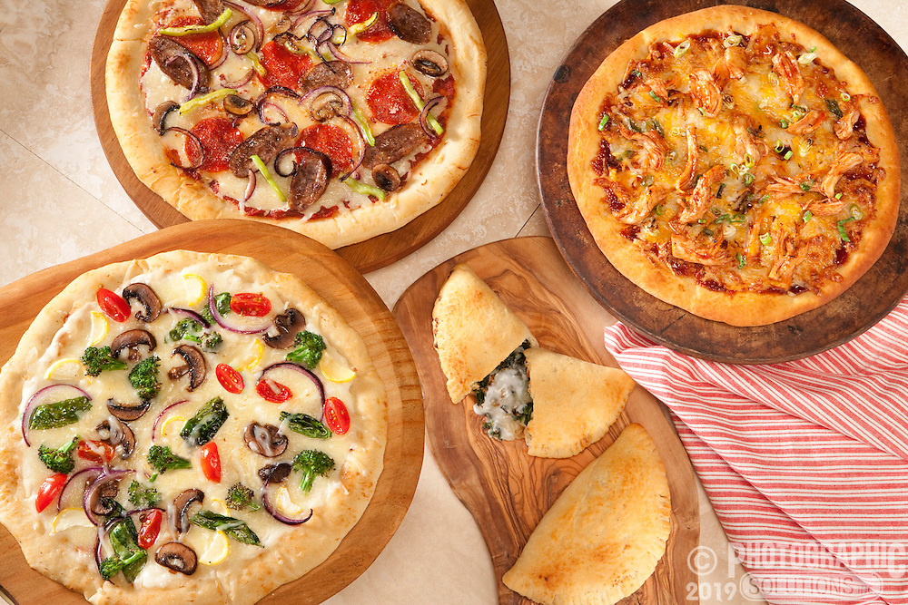 Three different delicious pizzas and calzone