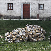 """Wood outside a house. There are several arguments about the derivation of the name  """"Montenegro"""", one of these relates to dark and deep forests  that once covered the Dinaric Alps, as it was possible to see them from the sea. <br /> Mostly mountainous with 672180 habitants on an area of 13812 Km², with a population density of  48 habitants/Km². <br /> It borders with Bosnia, Serbia, Croatia, Kosovo and Albania but  Montenegro has always been alien to the bloody political events that characterized Eastern Europe in recent decades. <br /> From 3 June 2006, breaking away from Serbia, Montenegro became an independent state. <br /> In the balance between economy devoted to sheep farming and a shy tourist, mostly coming from Bosnia and Herzegovina, Montenegro looks to Europe with a largely unspoiled natural beauty. <br /> Several cities in Montenegro, as well as the park Durmitor, considered World Heritage by UNESCO but not yet officially because Montenegro has yet to ratify the World Heritage Convention of UNESCO."""