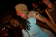 """Foreign tourists, principally backpackers and local Malawian get into the groove and dance late into the night with a mix of African bands and """"imported"""" music from UK based DJ's at the Lake of Stars music festival, Chinteche, Malawi."""