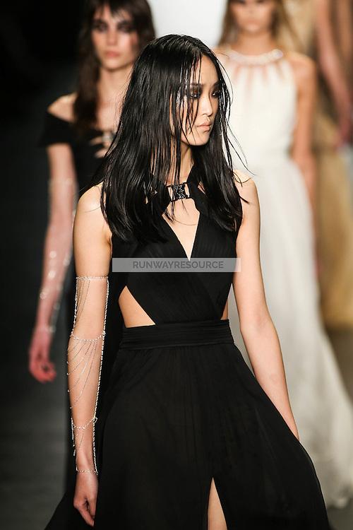 Yue Han (Wilhelmina) walks the runway wearing Tadashi Shoji Fall 2016 during New York Fashion Week on February 12, 2016