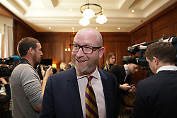 © Licensed to London News Pictures . 27/03/2017 . London , UK. UKIP leader Paul Nuttall delivers a speech setting out six tests on which UKIP will judge British Prime Minister Theresa May's Brexit negotiations , at the Marriott County Hall in Westminster, attended by Nigel Farage  . On Wednesday the British Government will trigger Article 50 of the Lisbon Treaty and commence Britain's withdrawal from the European Union . Photo credit : Joel Goodman/LNP