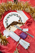 A half eaten Christmas cake and festive table decorations on the 24th December 2018 in London in the United Kingdom.