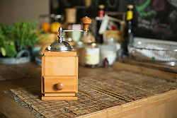 Coffee grinder on table in kitchen, Munich, Bavaria, Germany