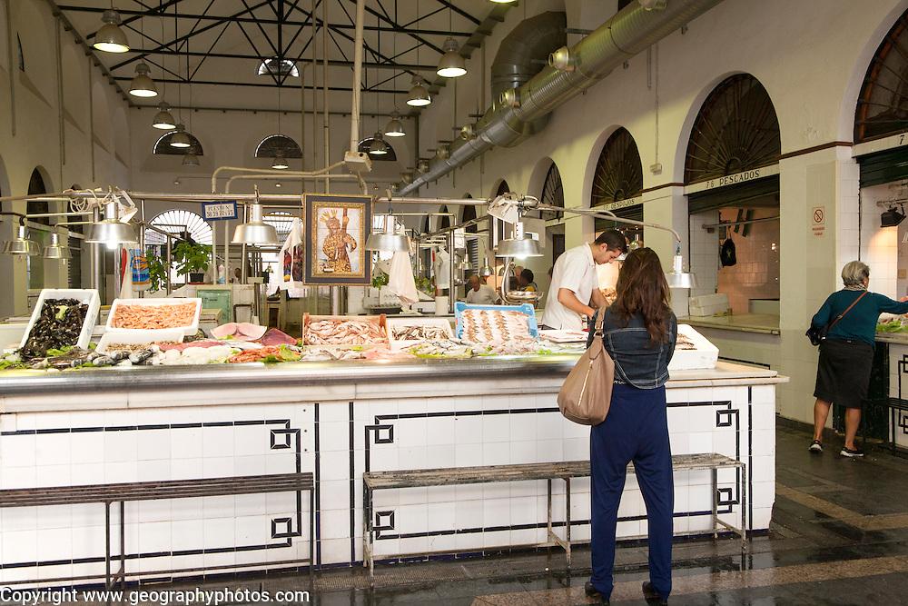 Fishmonger stalls inside Bario Macerana market, city centre of Seville, Spain