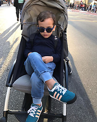 """Naomi Campbell releases a photo on Instagram with the following caption: """"#sundaystroll my #godson #marco @maresmguia taking it easy #proudgodmother \ud83c\udde7\ud83c\uddf7\u2764\ufe0f\u2764\ufe0f\u2764\ufe0f\ud83d\ude18\ud83d\ude18\ud83d\ude18\ud83d\ude4f\ud83c\udffe"""". Photo Credit: Instagram *** No USA Distribution *** For Editorial Use Only *** Not to be Published in Books or Photo Books ***  Please note: Fees charged by the agency are for the agency's services only, and do not, nor are they intended to, convey to the user any ownership of Copyright or License in the material. The agency does not claim any ownership including but not limited to Copyright or License in the attached material. By publishing this material you expressly agree to indemnify and to hold the agency and its directors, shareholders and employees harmless from any loss, claims, damages, demands, expenses (including legal fees), or any causes of action or allegation against the agency arising out of or connected in any way with publication of the material."""