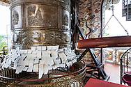 Prayers stuck on a bell, Linh Phuoc Pagoda, Da Lat, Vietnam, Southeast Asia