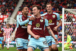 Burnley's Ashley Barnes (centre) celebrates scoring his side's first goal of the game during the Premier League match at the bet365 Stadium, Stoke.