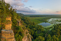 Inspiration Point is located in the Larue-Pine Hills in the far southern part of the state. Below the cliffs lies a marshy area that is part of the Mississippi River floodplain. In the distance the river itself can be seen, along with the hills of Missouri. The view can look different depending on the time of year and the water level. Even though the weather had been quite dry, a thunderstorm had just passed through a few hours earlier. The storm cleared the hazy air and seemed to make the colors even more vivid. Evening is the best time to visit this viewpoint as you can watch the sun set to the west and light up the cliffs and the wetlands below with a golden glow. At the bottom center of the photo you can see Snake Road. Twice a year this road is closed to vehicle traffic to allow the large population of snakes to migrate back and forth from the cliffs to the swamp.<br />
