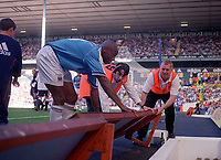 Paolo Wanchope (Manchester City) helps to re-arrange the advertising board after falling on it. Tottenham Hotspur v Manchester City, FA Premiership, 23/09/2000. Credit: Colorsport / Nick Kidd