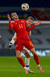 CARDIFF, WALES - Wednesday, November 18, 2020: Wales' captain Gareth Bale (L) and Finland's Rasmus Schüller during the UEFA Nations League Group Stage League B Group 4 match between Wales and Finland at the Cardiff City Stadium. Wales won 3-1 and finished top of Group 4, winning promotion to League A. (Pic by David Rawcliffe/Propaganda)