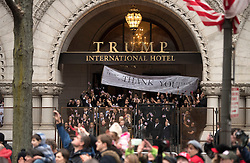 People watch from the Trump International Hotel as President Donald Trump and First Lady Melania Trump walk in their inaugural parade after being sworn-in as the 45th President in Washington, D.C. on January 20, 2017. Photo by Kevin Dietsch/UPI