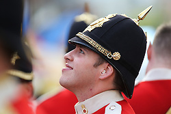 © Licensed to London News Pictures. 28/09/2016. Leeds, UK. A a band member looks up and smiles  during the Olympic and Paralympic parade in Leeds. Yorkshire's Olympic and Paralympic stars receive a heroes' welcome during an open top bus parade in Leeds, West Yorkshire.  Photo credit : Ian Hinchliffe/LNP
