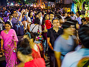 30 SEPTEMBER 2017 - BANGKOK, THAILAND: A man uses his smart phone to photograph the crowd during the Navratri parade in Bangkok. Navratri is a nine night (10 day) long Hindu celebration that marks the end of the monsoon and honors of the divine feminine Devi (Durga). The festival is celebrated differently in different parts of India, but the common theme is the battle and victory of Good over Evil based on a regionally famous epic or legend such as the Ramayana or the Devi Mahatmya. Navratri is celebrated throughout Southeast Asia in communities that have large Hindu population. Bangkok's celebration of Navratri was subdued this year because Thais are still mourning the death of Bhumibol Adulyadej, the Late King of Thailand, who died on October 13, 2016.      PHOTO BY JACK KURTZ
