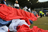 Football - 2018 / 2019 Premier League - Cardiff City vs. Leicester City<br /> <br /> Fans behind a giant Thai flag in Leicster's 1st match since the death of Vichai Srivaddhanaprabha, at Cardiff City Stadium.<br /> <br /> COLORSPORT/WINSTON BYNORTH