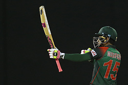 March 14, 2018 - Colombo, Sri Lanka - Bangladesh cricketer Mushfiqur Rahim celebrates after scoring 50 runs during the 5th Twenty-20 cricket match of NIDAHAS Trophy between Bangladesh and India at R Premadasa cricket ground, Colombo, Sri Lanka on Wednesday 14 March 2018. (Credit Image: © Tharaka Basnayaka/NurPhoto via ZUMA Press)