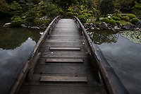 """Shinsetsu-kyo  at Shosei-en - A wooden bridge called Shinsetsu-kyo connects the west edge of Ingetsu-ichi pond and Kita-oshima, the north island. Shosei-en Garden was designed as a retreat for the chief priest Sen'nyo.  Shosei-en is also called Kikoku-tei """"Orange Mansion"""" because it was once surrounded by orange groves. The garden is a Chisen-Kaiyu-Shiki teien  that is a pond strolling garden with buildings such as tea-ceremony houses arranged here and there throughout the grounds."""