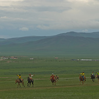 Young riders race their horses in a Naadam festival at Zuunmod, Mongolia, near Ullanbaator.