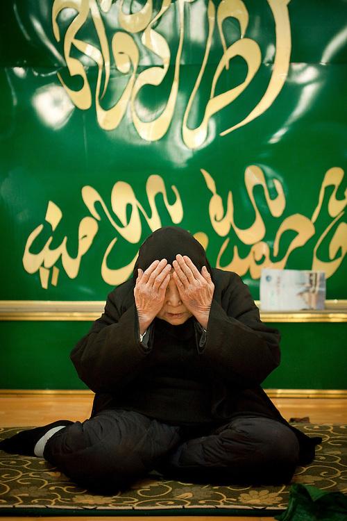 Du Shuzheng leads prayer at the Beidajie Women's Mosque in Zhengzhou, Henan province, China.