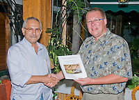 Professor Hinrich Kaiser of Victor Valley College, Victorville, California (right), presents his Initial Report on the Herpetofauna of Timor-Leste to President Jose Ramos-Horta at the President's home in Dili on February 4, 2010.  Professor Kaiser and his students are conducting the first scientific survey of the reptiles and amphibians of Timor-Leste (East Timor).