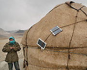 """Solar panels on a yurt in the Afghan Pamir. Camp at a Wakhi high pasture names """"Warm"""", below Garumdee Pass. Guiding and photographing Paul Salopek while trekking with 2 donkeys across the """"Roof of the World"""", through the Afghan Pamir and Hindukush mountains, into Pakistan and the Karakoram mountains of the Greater Western Himalaya."""