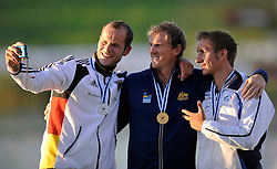(L) SILVER - MAX HOFF (GERMANY) & (C) GOLD - KEN WALLACE (AUSTRALIA) & (R) BRONZE - MAXIMILIAN BENASSI (ITALY) WHILE MEDAL CEREMONY AFTER MEN'S K1 5000 METERS FINAL A RACE DURING 2010 ICF KAYAK SPRINT WORLD CHAMPIONSHIPS ON MALTA LAKE IN POZNAN, POLAND...POLAND , POZNAN , AUGUST 21, 2010..( PHOTO BY ADAM NURKIEWICZ / MEDIASPORT ).