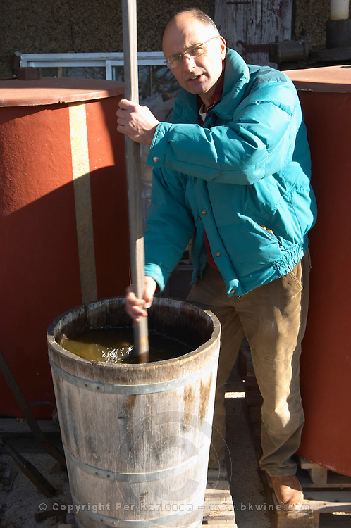 Bernard Bellahsen. Domaine Fontedicto, Caux. Pezenas region. Languedoc. A bio-dynamic dynamiser dynamiseur to make herbal infusions by stirring a mix of plants and herbs in water. Owner winemaker. France. Europe.