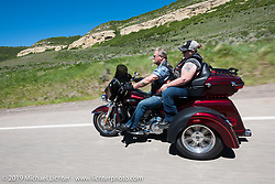 Ken and Tina Brown of Aurora, CO and members of the Aurora HOG Chapter on their 2017 Tri Glide riding the 20 Mile Road in Steamboat Springs during the Rocky Mountain Regional HOG Rally, Colorado, USA. Saturday June 10, 2017. Ken is a plumber and Tina is a phlebotomist. Photography ©2017 Michael Lichter.