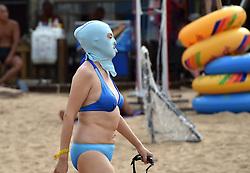 QINGDAO, Sept. 3, 2016 (Xinhua) -- A woman wearing facekini walks on a beach in Qingdao, east China's Shandong Province, Sept. 3, 2016. Facekini is a kind of mask designed for swimmers to protect their head and face. (Xinhua/Xu Suhui) (wjq) (Credit Image: © Xu Suhui/Xinhua via ZUMA Wire)
