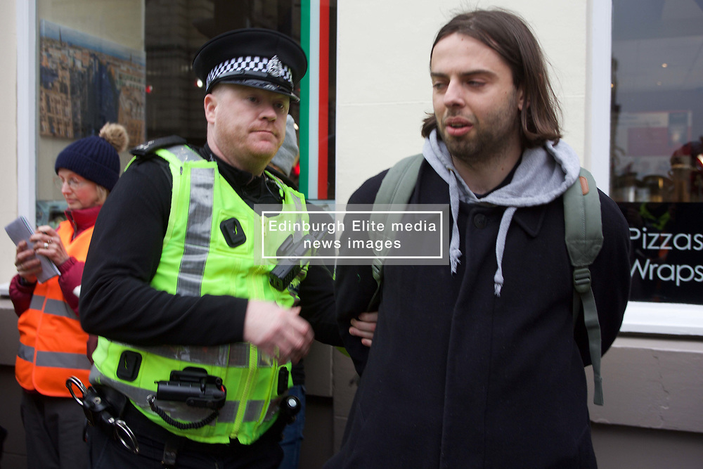 A protestor being led away at the rally on climate change pic copyright: Terry Murden @edinburghelitmedia