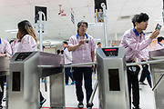 Employees swipe their id cards and stands in front of a facial recognition system before they are allowed onto the assembly line area at a Pegatron Corp. factory in Shanghai, China, on Friday, April 15, 2016. This is the realm in which the worlds most profitable smartphones are made, part of Apple Inc.s closely guarded supply chain.