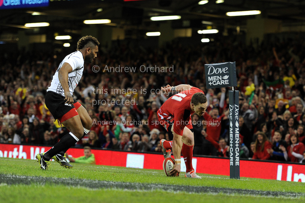 George North of Wales scores his teams 1st try. Dove Men series 2014, autumn international rugby, Wales v Fiji at the Millennium Stadium in Cardiff, South Wales on Saturday 15th November 2014.<br /> pic by Andrew Orchard, Andrew Orchard sports photography.