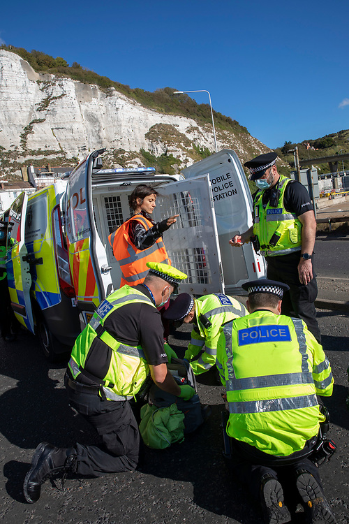Police start to arrest and detain activist from Insulate Britain who have blockaded the entrance to the port of Dover on the 24th of September 2021. Over 40 activists from Insulate Britain blocked the road with some gluing themselves to the carriageway of the A20 at the Eastern docks roundabout. There are blocking the roads to highlight that fuel poverty is killing people in Dover and across the UK. (photo by Andrew Aitchison / In pictures via Getty Images)