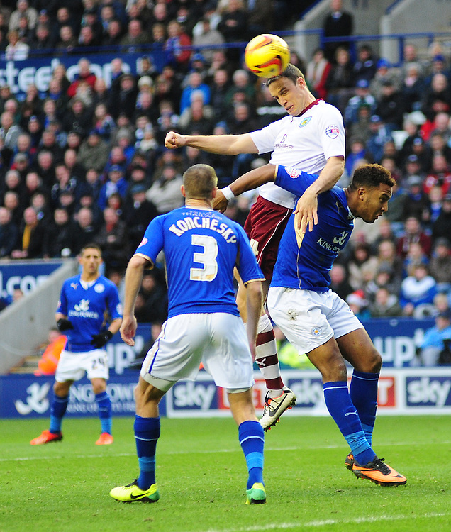 Burnley's Michael Duff vies for possession with Leicester City's Liam Moore <br /> <br /> Photo by Chris Vaughan/CameraSport<br /> <br /> Football - The Football League Sky Bet Championship - Leicester City v Burnley - Saturday 14th December 2013 - King Power Stadium - Leicester<br /> <br /> © CameraSport - 43 Linden Ave. Countesthorpe. Leicester. England. LE8 5PG - Tel: +44 (0) 116 277 4147 - admin@camerasport.com - www.camerasport.com