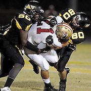 Ashley High School's Anthony Andrews is tackles by Topsail's Jakeem Smith, left and Tyler Andrews October 4, 2013. (Jason A. Frizzelle)