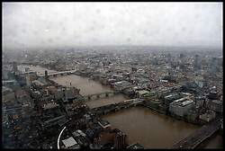 The View in the rain  from the Shard as the London Mayor Boris Johnson officially opens the Shard building to the General public, central London, Friday February 1, 2013. Photo By Andrew Parsons / i-Images