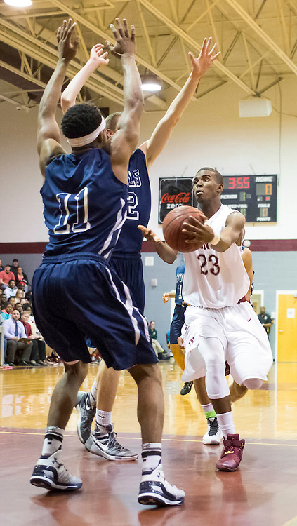 Jay M Robinson's Lavar Batts, Jr. (23) passes the ball against the Hickory Ridge defense during a 3A west state basketball playoff game Thursday, February 25, 2016 at Jay M Robinson High School in Concord, NC. Photo by JASON E. MICZEK - www.miczekphoto.com