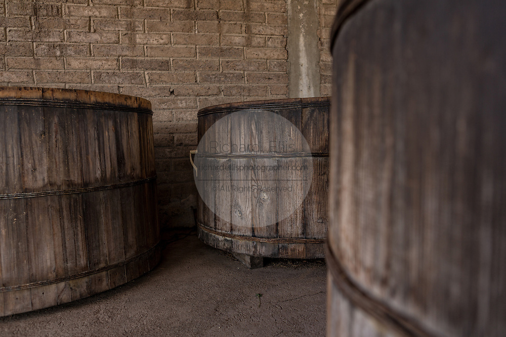 Wooden vats filled with agave mash an artisanal Mezcal distillery November 5, 2014 in Matatlan, Mexico. Making Mezcal involves roasting the blue agave hearts, crushing it and then fermenting the liquid.