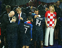 French President Emmanuel Macron on the stage with Fifa President Giovanni Infantino, Russian Federation President Vladimir Putin and Croatia President Olinda Grabar-Kitarovic congratulating Blaise Matuidi (France)<br /> Celebration Victory France <br /> Moscow 15-07-2018 Football FIFA World Cup Russia  2018 Final / Finale <br /> France - Croatia / Francia - Croazia <br /> Foto Matteo Ciambelli/Insidefoto
