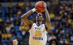 Jan 12, 2019; Morgantown, WV, USA; West Virginia Mountaineers forward Lamont West (15) shoots a foul shot during the second half against the Oklahoma State Cowboys at WVU Coliseum. Mandatory Credit: Ben Queen-USA TODAY Sports
