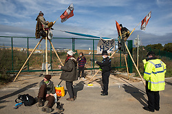 West Hyde, UK. 9th September, 2020. Anti-HS2 activists use tripods to block one of several entrances to the Chiltern Tunnel South Portal site for the HS2 high-speed rail link for the entire day. The protest action, at the site from which HS2 Ltd intends to drill a 10-mile tunnel through the Chilterns, was intended to remind Prime Minister Boris Johnson that he committed to remove deforestation from supply chains and to provide legal protection for 30% of UK land for biodiversity by 2030 at the first UN Summit on Biodiversity on 30th September.
