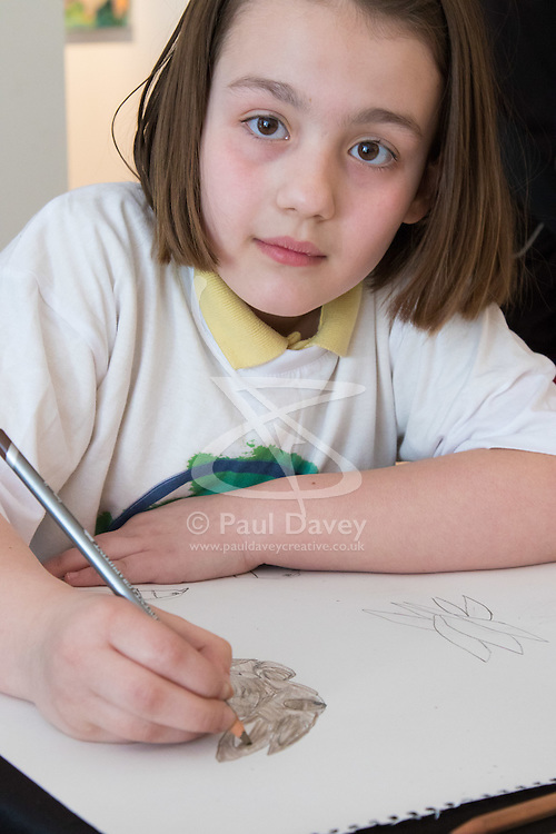 Christies, St James, London, March 4th 2016. Nine year-old Ashley Hubbard creates an artwork at the preview for the It's Our World charity auction at Christie's. Over 40 leading artists including David Hockney, Sir Antony Gormley, David Nash, Sir Peter Blake, Yinka Shonibare, Sir Quentin Blake, Emily Young and Maggi Hambling have committed artworks to the It's Our World Auction in support of The Big Draw and Jupiter Artland Foundation, to be sold at Christie's London on 10 March 2016.<br />  ///FOR LICENCING CONTACT: paul@pauldaveycreative.co.uk TEL:+44 (0) 7966 016 296 or +44 (0) 20 8969 6875. ©2015 Paul R Davey. All rights reserved.