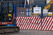Ecocide graffiti at the construction site for the HS2 mainline station at Curzon Street on 14th July 2021 in Birmingham, United Kingdom. The Curzon Street Masterplan covers a 141 hectare area of regeneration, focussed on HS2 Curzon Street station in Birmingham city centre, combined with approximately 700 million in investment into the surrounding area including new homes and commercial developments. High Speed 2 is a partly planned high speed railway in the United Kingdom with its first phase in the early stages of construction, the second phase is yet to receive full approval and the third is subject to merging with Northern Powerhouse Rail, a separate project.