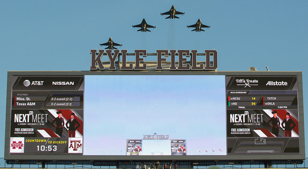 A squadron of F16's fly over Kyle Field before the start of an NCAA college football game between Mississippi State and Texas A&M on Saturday, Oct. 28, 2017, in College Station, Texas. (AP Photo/Sam Craft)