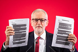 © Licensed to London News Pictures. 27/11/2019. London, UK. Leader of the Labour Party Jeremy Corbyn holds up a redacted copy of a report on trade negotiations with the United States that may affect the NHS at an event in Westminster. Photo credit: Rob Pinney/LNP