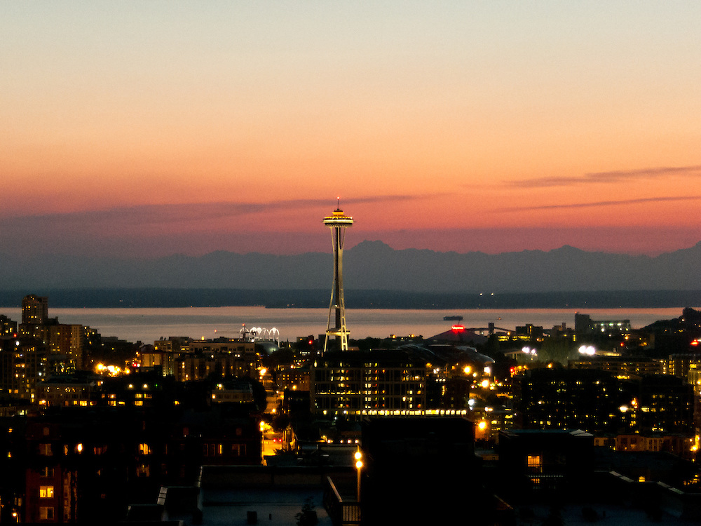 The space Needle and Olympic Mountains during sunset.