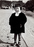 three years old girl made up for her Shichi Go San celebration Japan 1950s