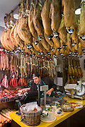 Man at work in butcher's shop selling Iberico Ham and other meats in Calle de Bidebarrieta in Bilbao, Spain