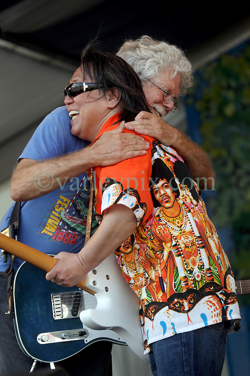 29 April 2012. New Orleans, Louisiana,  USA. <br /> New Orleans Jazz and Heritage Festival. <br /> Legendary guitar player June Yamagishi (rt) of Papa Grows Funk is joined by Fred Tackett.<br /> Photo Credit; Charlie Varley/varleypix.com
