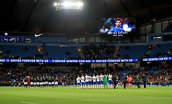 The two teams stand for a tribute to Davide Astori who died recently