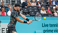 Tennis - 2019 Queen's Club Fever-Tree Championships - Day Three, Wednesday<br /> <br /> Men's Singles, First Round: Stefanos Tsitsipas (GRC) Vs. Kyle Edmund (GBR)<br /> <br /> Kyle Edmund (GBR) strike the backhand return on Centre Court.<br />  <br /> COLORSPORT/DANIEL BEARHAM